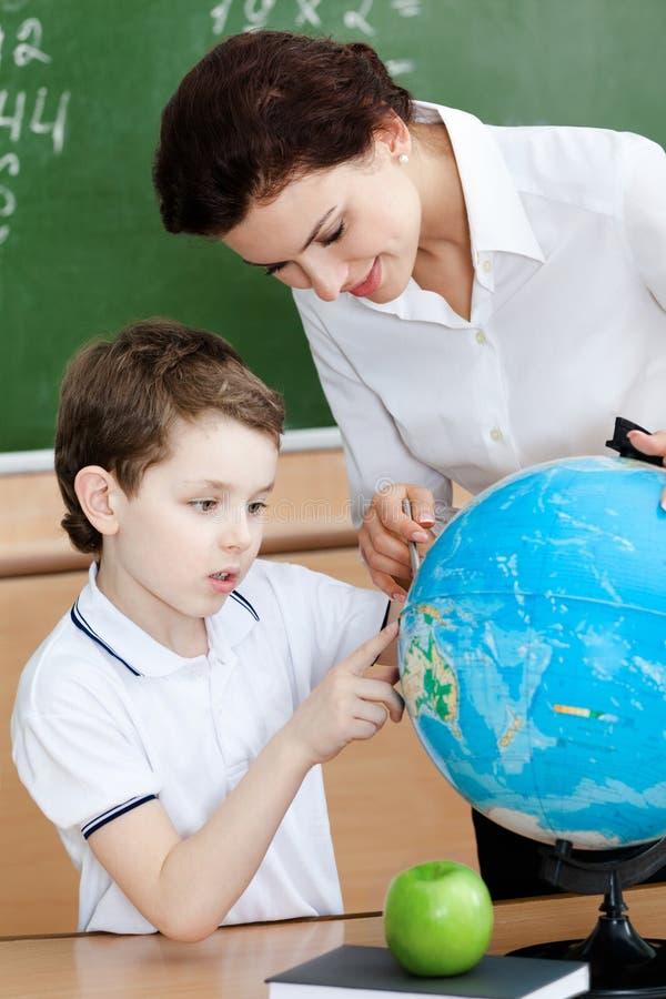 Download Little Schoolboy Studies Geography Stock Photo - Image of blackboard, brown: 26323260