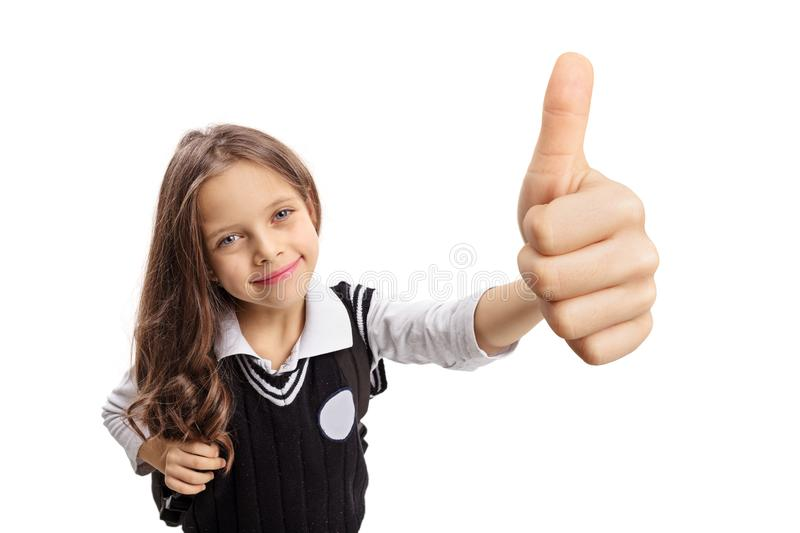 Little schoolgirl making a thumb up sign royalty free stock photography