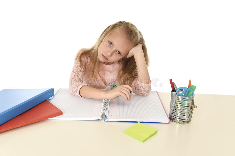 Little schoolgirl sad and tired looking depressed suffering stress overwhelmed by load of homework. Sweet little schoolgirl sad and tired looking depressed royalty free stock photos