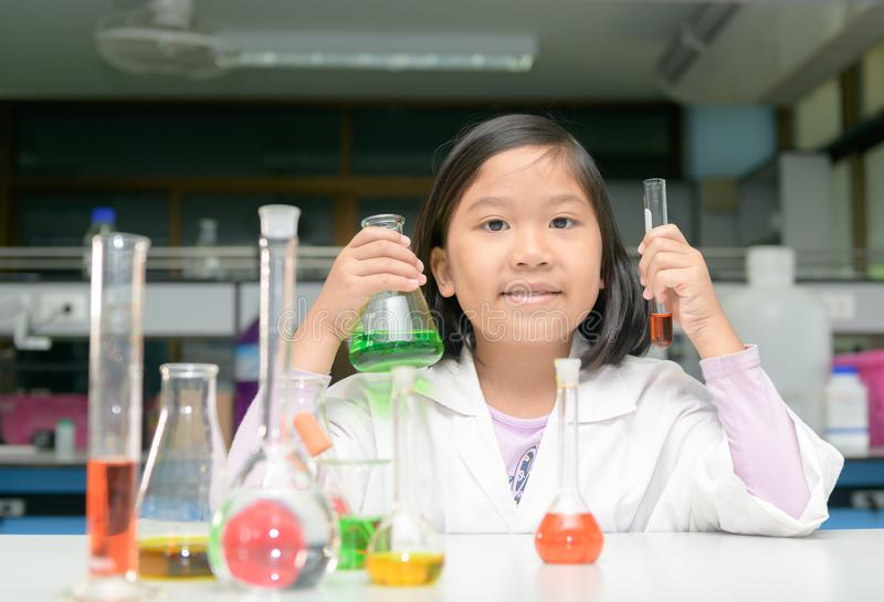 Little scienctist making experiment in laboratory, stock photos