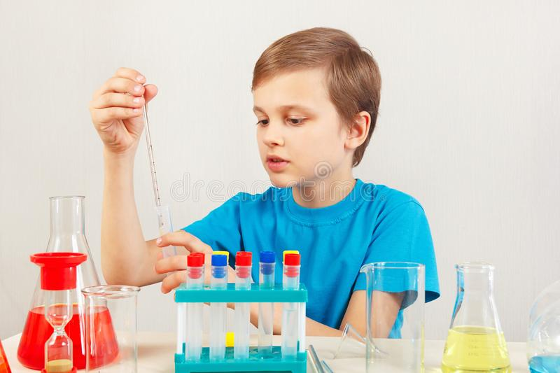Little scientist doing chemical experiments in laboratory. Little scientist doing chemical experiments in the laboratory royalty free stock photo
