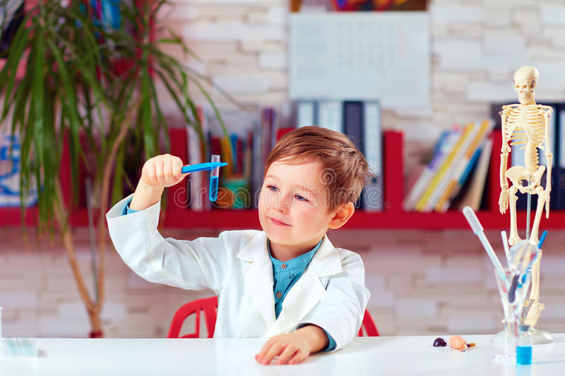 Little scientist making experiment on practical lesson in classroom stock photos