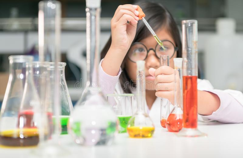 Little scientist making experiment with test tube stock photography