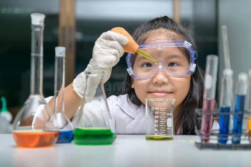 Little scientist wearing safty goggle  making experiment stock image