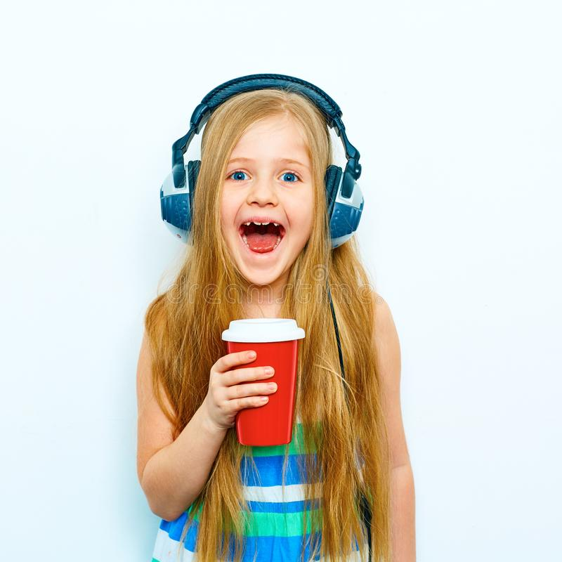 Little screaming girl standing against white background with re stock image