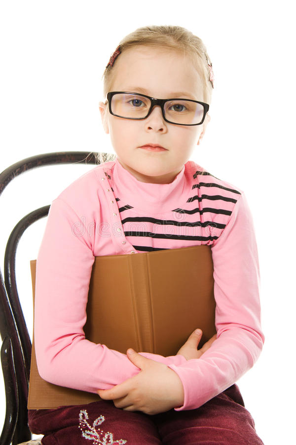 Download The Little Serious Girl In Glasses With A Book Stock Photo - Image: 25839898