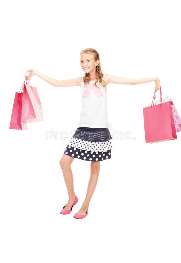 Little shopper. Happy girl with shopping bags over white royalty free stock images