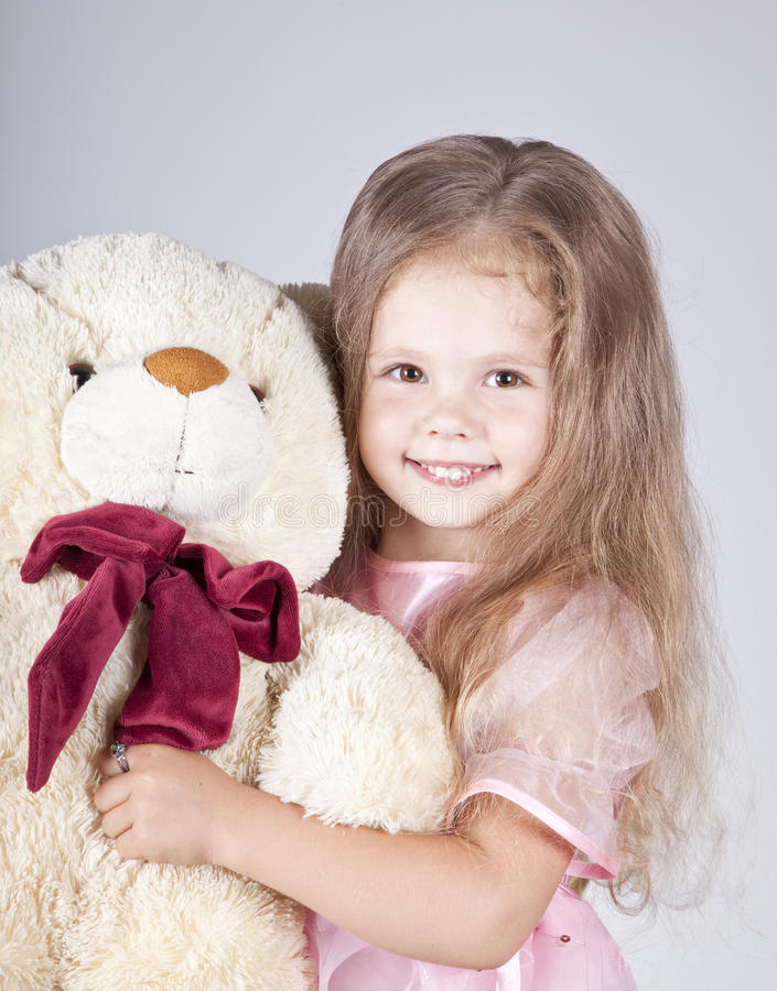 Download Little Shouting Girl Embraces Bear Cub. Royalty Free Stock Photography - Image: 15154587