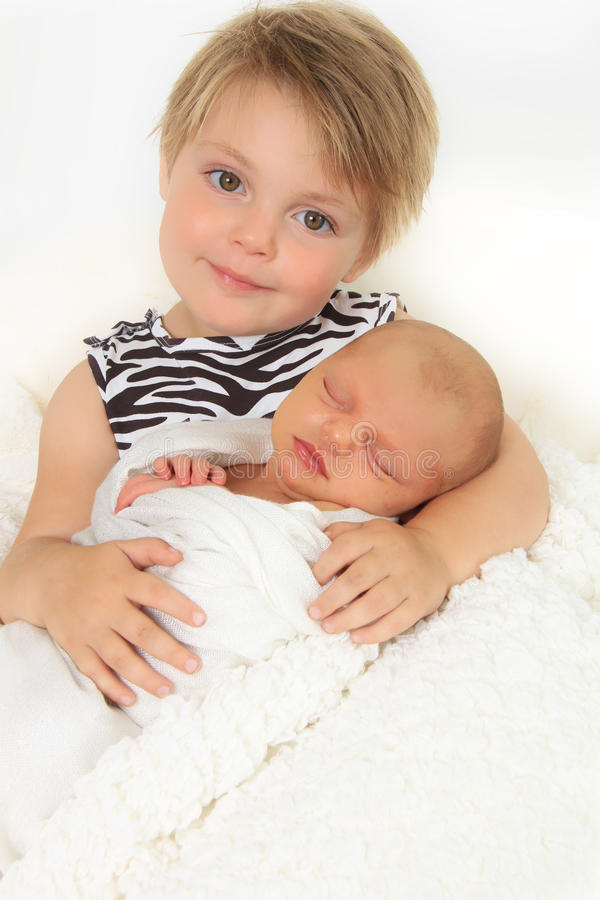 Little sisters. Little girl and her newborn baby sister royalty free stock photos