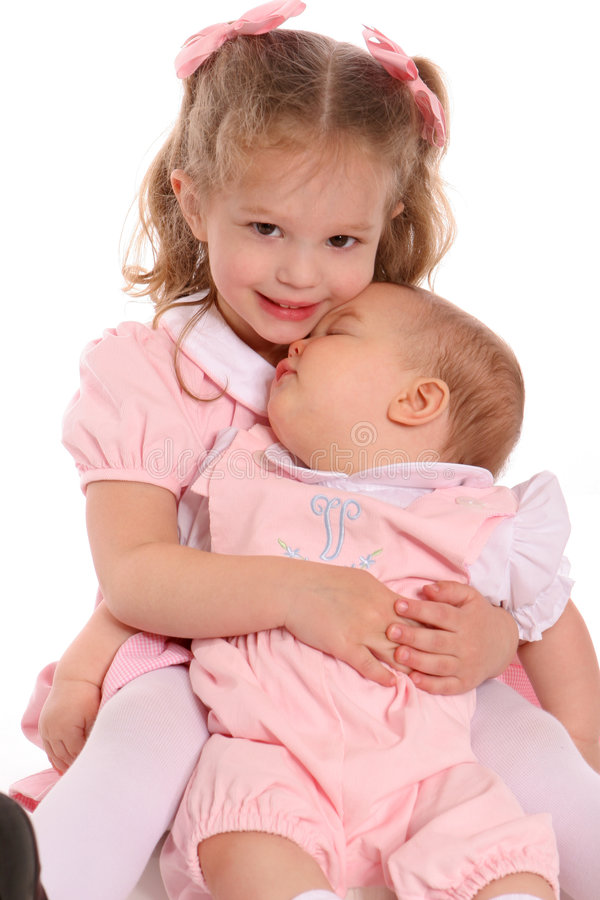 Little sisters hugging stock photography