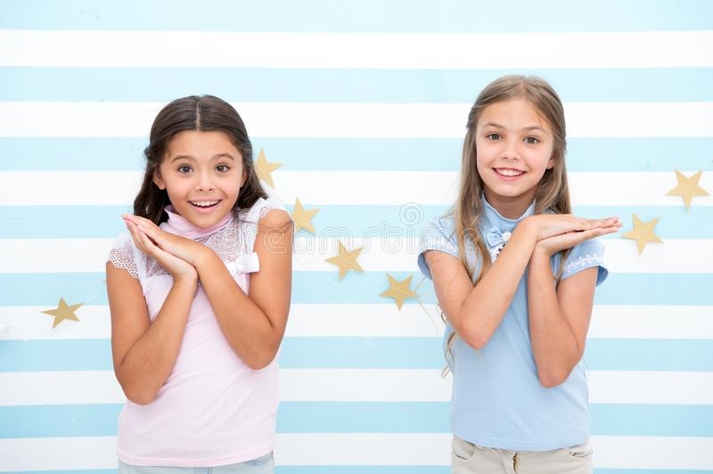 Little sisters. little sisters with brunette and blonde hair smiling. family values. royalty free stock images