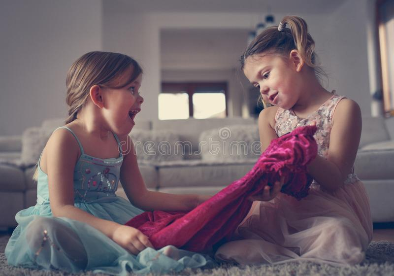 Little sisters pick dress together. Close up image of two little girls. Sisters time royalty free stock images