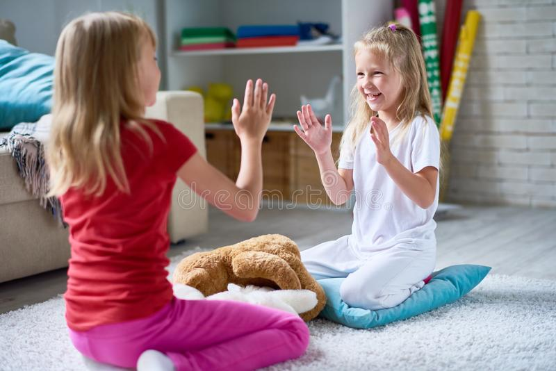 Little Sisters Playing Clapping Game stock photo