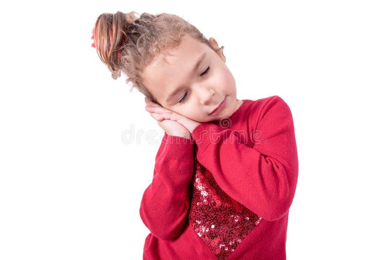 Little sleepy girl. Portrait of little and sleepy kid,isolated on white background stock photo