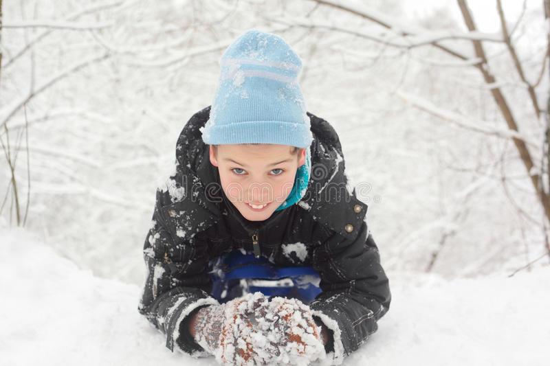 Download Little Smile Boy Lie On Snow Stock Image - Image: 28023305