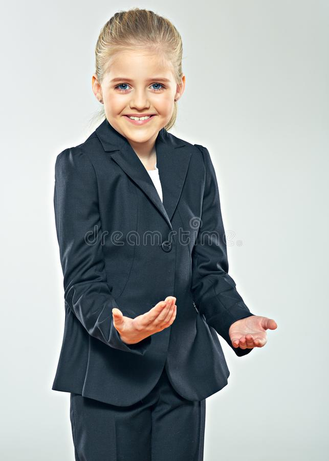 Child girl in business suit. Smiling schoolgirl. stock photography