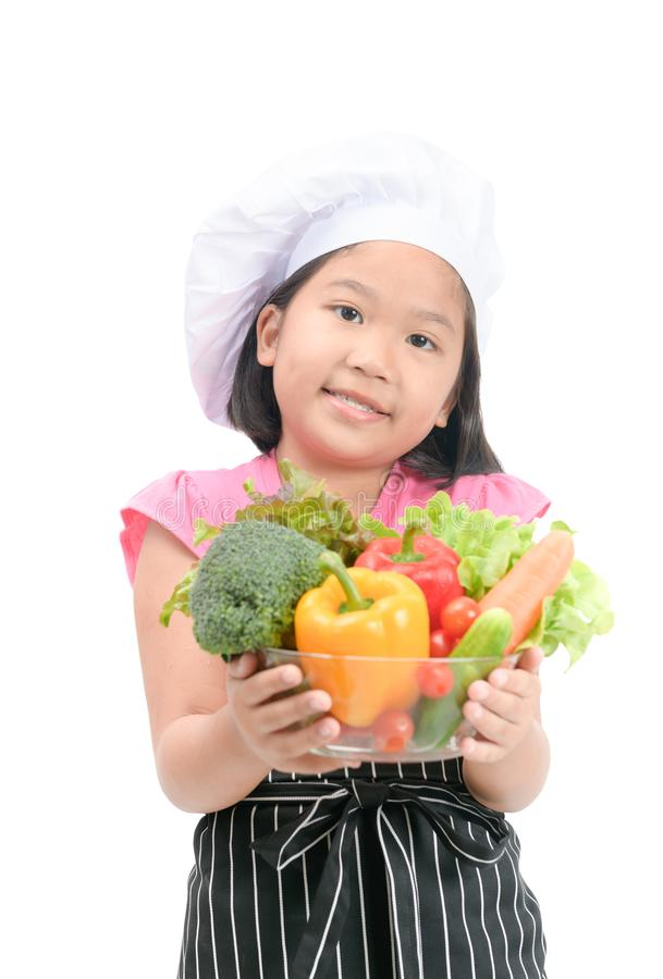 Little smiling chef holding mix vegetables isolated stock image