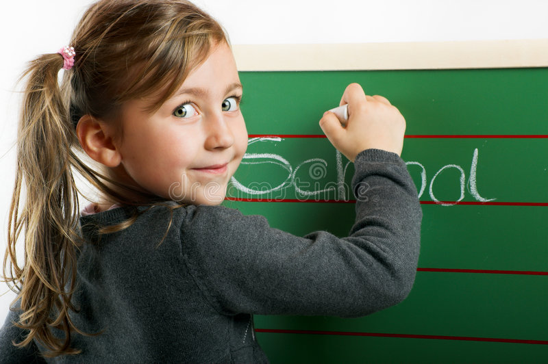 Little smiling girl on a board stock photo