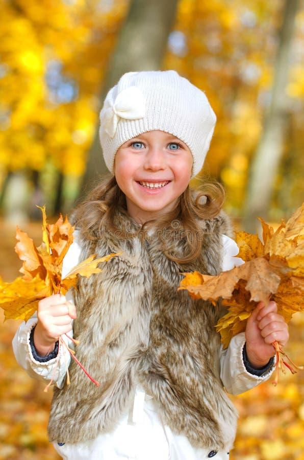 Download Little smiling girl stock image. Image of face, leaf - 34431883