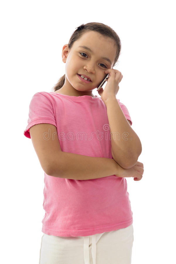 Little Smiling Girl Having a Phone Conversation royalty free stock photo