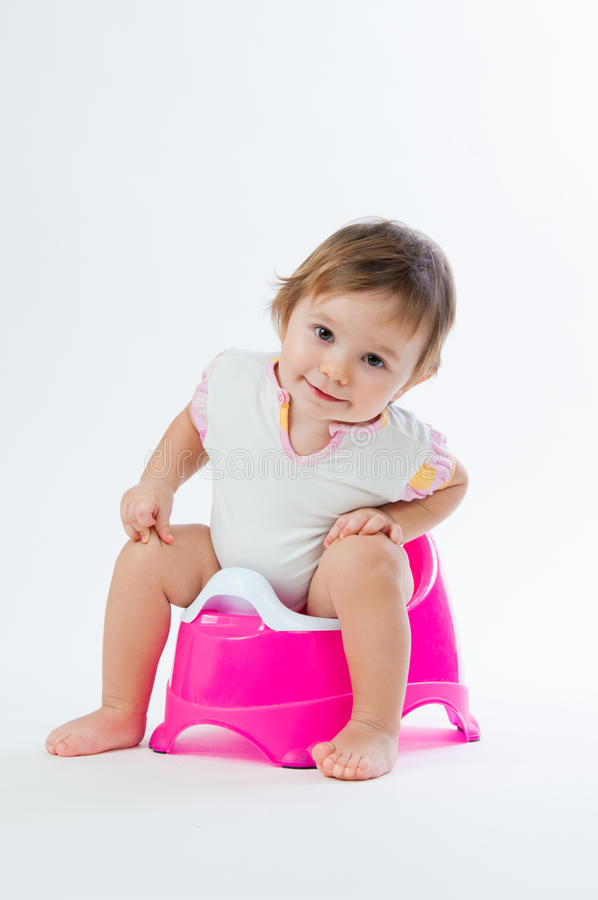 Free Little Smiling Girl Sitting On A Pot. Isolated On White Background. Royalty Free Stock Images - 88024129