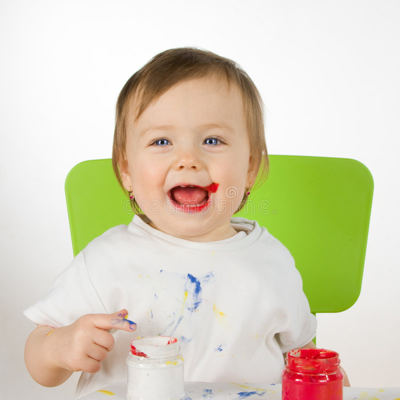 Little smiling paintress royalty free stock image