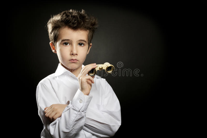 Little snobish boy with theater binoculars stock photos
