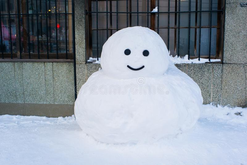 Little snowman in winter outdoor. Happy holiday and celebration.  Christmas or xmas decoration. royalty free stock image