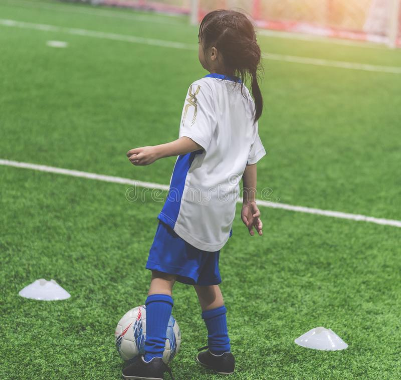 Little soccer girl training indoor soccer sport field royalty free stock photography