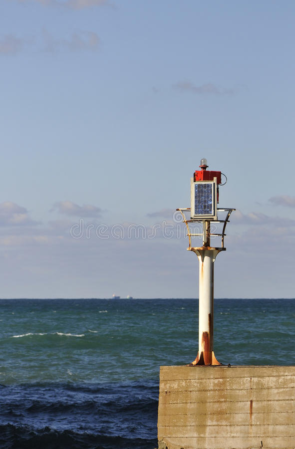 Download Little Solar Lighthouse On A Concrete Jetty Stock Photo - Image: 17282678