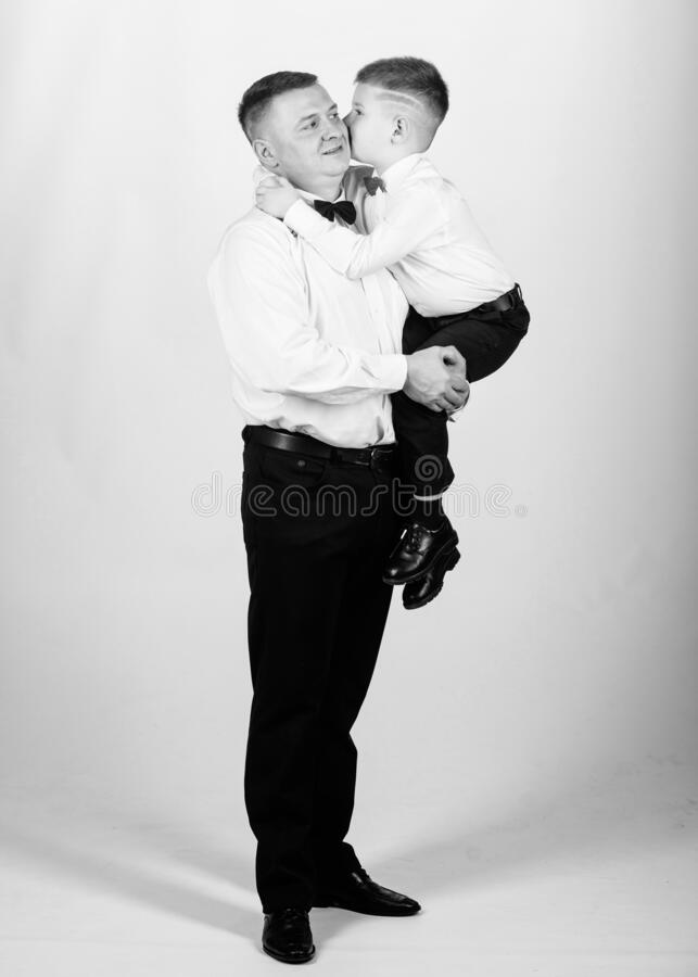 Little son following fathers example of noble man. Family holiday. Relations of dad and son. Gentleman upbringing. Father and son formal clothes outfit. Grow stock images