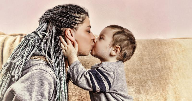 The little son kisses his mother. close up royalty free stock images