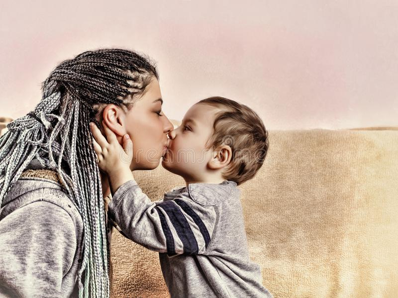The little son kisses his mother. close up royalty free stock photography