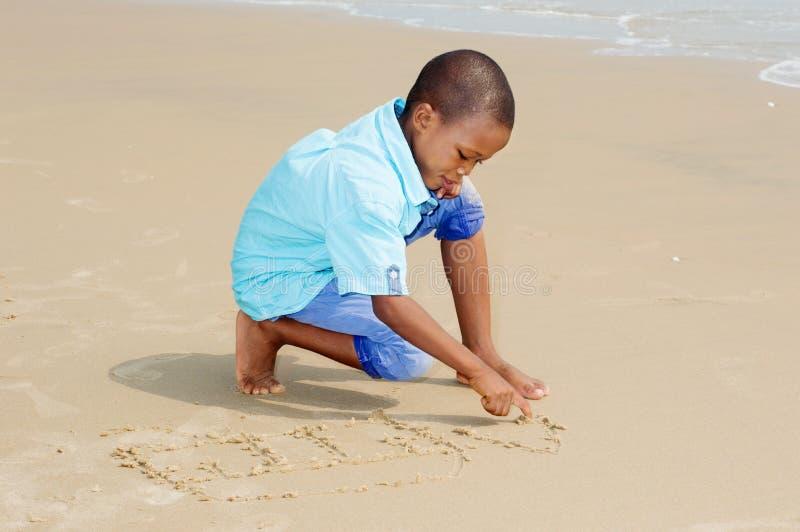 Little boy having fun at the beach stock photography