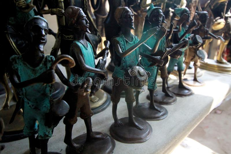 Little statues at the central artisan market in Accra, Ghana. Of musicians with their local instruments at a makeshift stall royalty free stock image