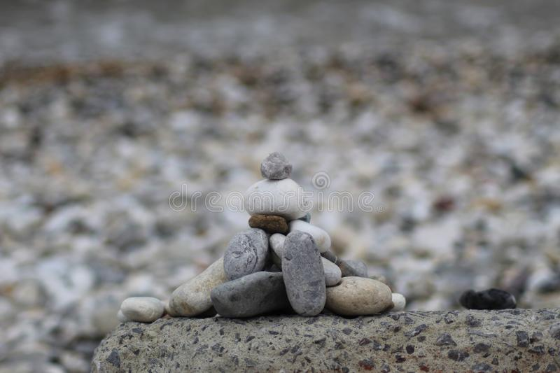 The little stones on a big rock at a afternoon at the beach. stock photo