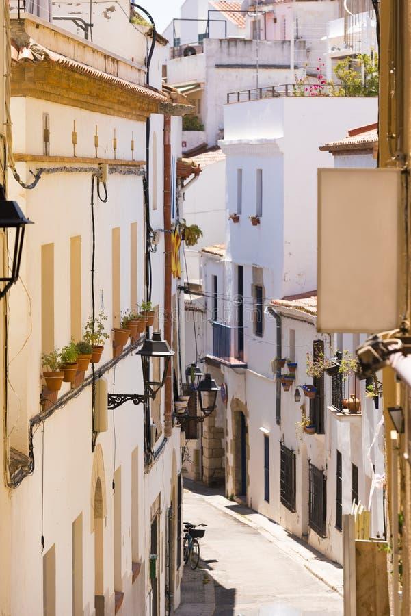 Little street of the historic city center Sitges, Barcelona, Catalunya, Spain. Vertical. Little street of the historic city center Sitges, Barcelona, Catalunya stock image