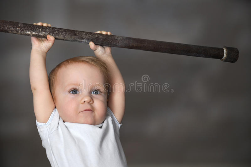Little strong baby toddler playing sports. Kid during his workout. Success and winner concept royalty free stock photo