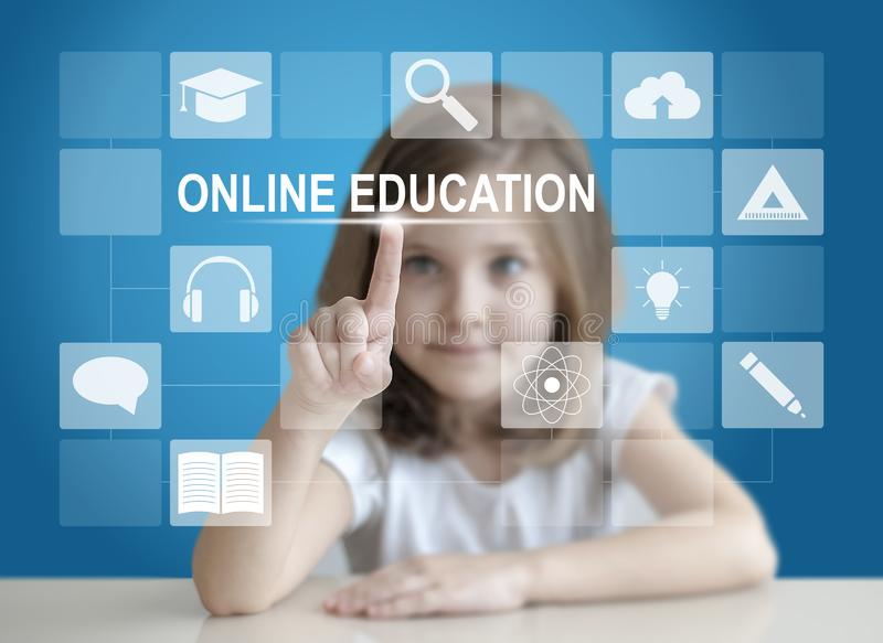 Little student girl choosing icon on virtual touch screen. Baby using a touch screen interface. Digital learning. E-learning royalty free stock photos