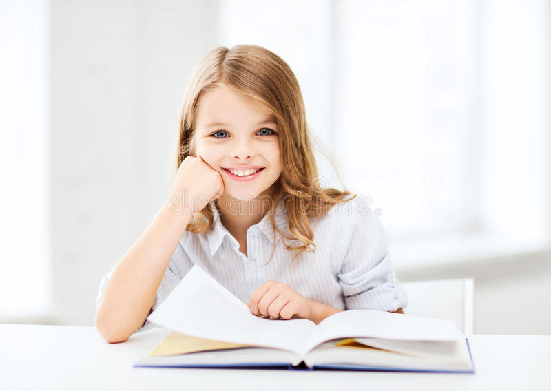 Little Student Girl Studying At School Royalty Free Stock Images