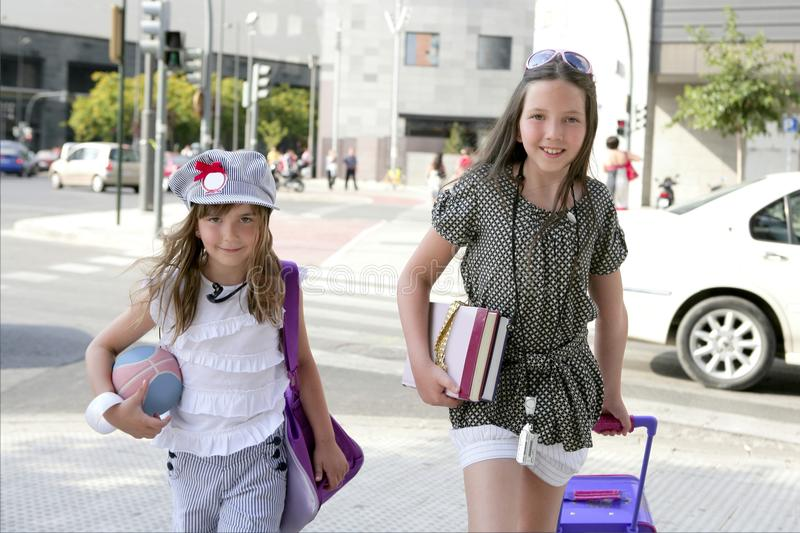 Download Little Student Girls Going To School In City Stock Photos - Image: 10357933