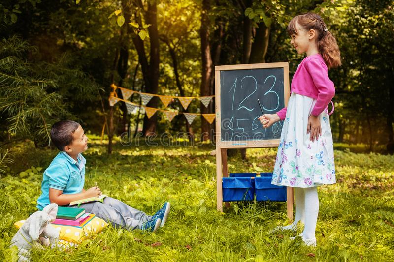 Little students learn numbers. Back to school. The concept of education, school, childhood. Study stock photos