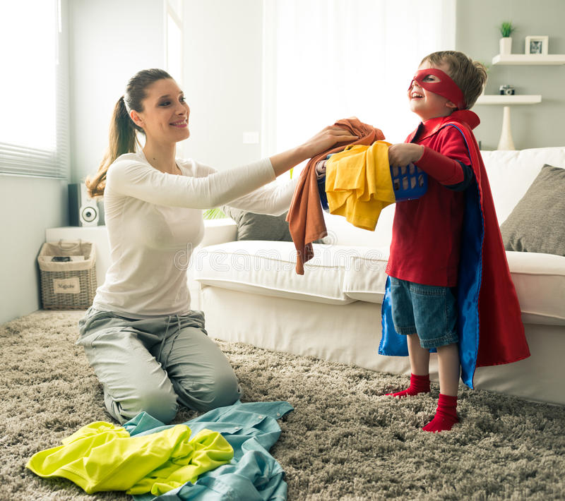 Little superhero helping his mother royalty free stock photo