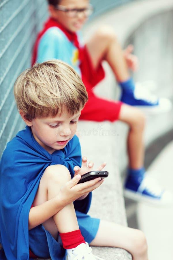 Download Little Superhero With Smartphone Stock Photo - Image: 34060492