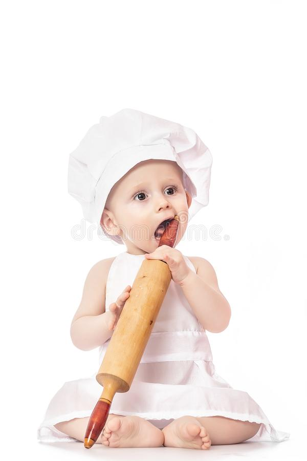 Little sweet cook  on white background. Use it for child, healthy food concept royalty free stock images