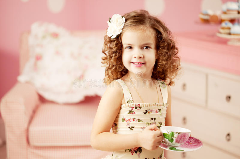 Download Little sweet girl with tea stock photo. Image of emotional - 33639780