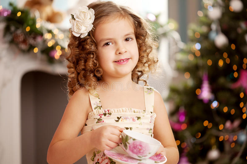 Little sweet girl with tea. Little cute and sweet girl with tea royalty free stock photo