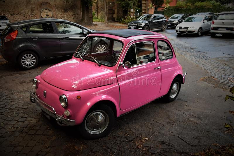 Little Sweet Old Pink Fiat 500. In Rome stock photos