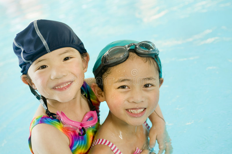 Little Swimmers. A young asian girl in the swimming pool royalty free stock image