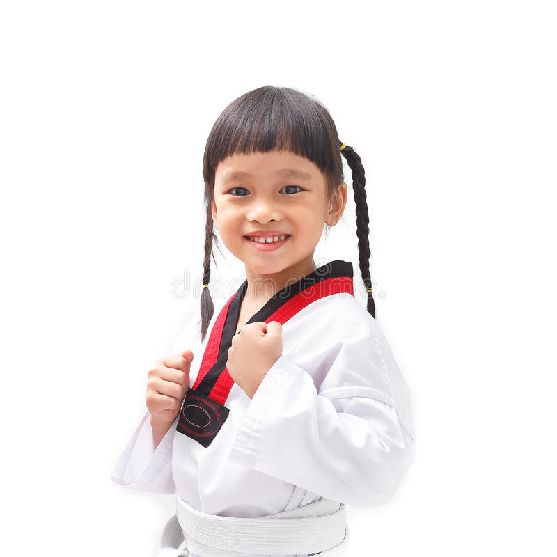 Little taekwondo. Little asian child in taekwondo fighting action on isolated background royalty free stock photos